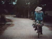 Woman riding bike in Vietnam
