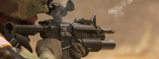 Gun firing a bullet